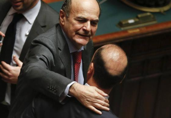 PD leader Bersani embraces PDL secretary Alfano during the presidential election in the lower house of the parliament in Rome